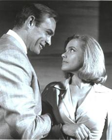 "3. Honor Blackman as Pussy Galore in ""Goldfinger"" (1964): Blackman gets a wardrobe that's part tough (well, as tough as you can find a 1964 James Bond film) and part feminine, plus a fabulous hairstyle that barely moves in any fight scene. The film is also notable for Shirley Eaton slathered entirely in gold paint and Sean Connery's powder blue terry cloth one-piece. It takes a real man to wear a terry cloth one-piece."